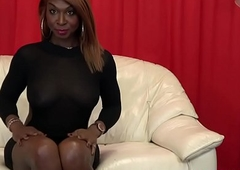 Busty black tgirl taunts before masturbating