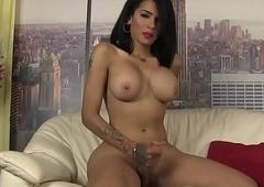 Elegant tranny jerking her dick passionately