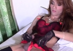 Glamcore ladyboy masturbating far downwards