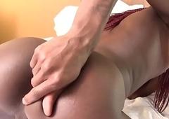 Finger banged black ts pleasures her asshole