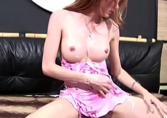 Kinky t-girl in pink dress exposes and squeezes her bigtits