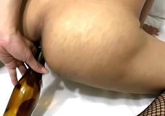 Thai tranny fucks beer bottle and deepthroats massive dick