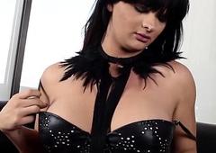 Kinky lady-boy in corset wanking off