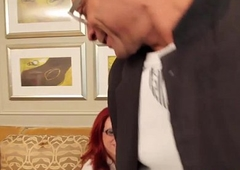 Redhead ladyboy in stockings and spex