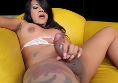 Tatted shemale posing and tugging her load of shit