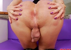 Huge ass tranny Paula D Avila wanks her broad in the beam hard schlong